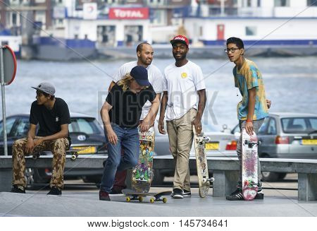 DORDRECHT NETHERLANDS - 3 SEPTEMBER 2016: Skateboarders hanging out at the official opening of the new skateboard park in Dordrecht.