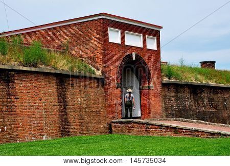 Baltimore Maryland - July 24 2013: U. S. Park Ranger stands at the sally port entrance to Fort McHenry National Historic Park