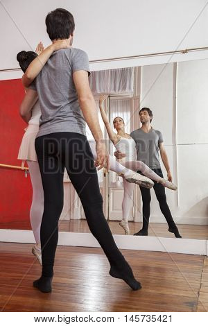 Trainer Practicing With Ballerina In Front Of Mirror