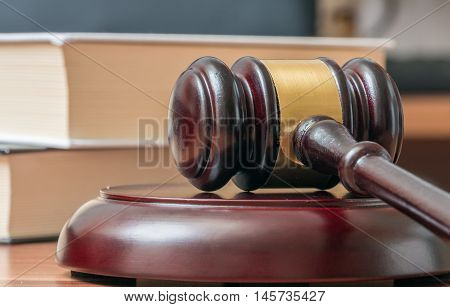 Auction Gavel With Books In Background. Justice And Auction Conc