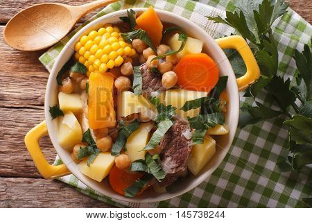 South American Cuisine: Thick Soup Pouchero Close-up In A Pot. Horizontal Top View