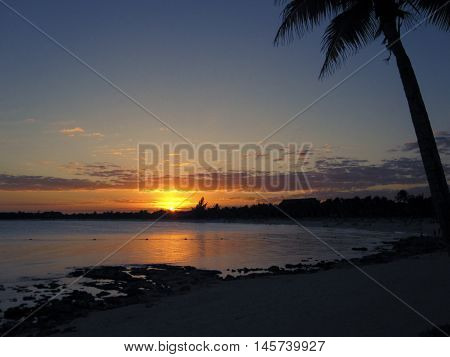 Sunset on Caribbean beach in Mayan Riviera Mexico