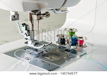 Close Up View Of Sewing Machine With Reels