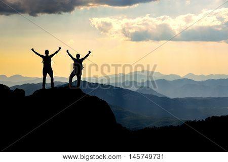 actual summit success.mountaineering activities.crazy climbers.mountain ridge.mountaineer and success.