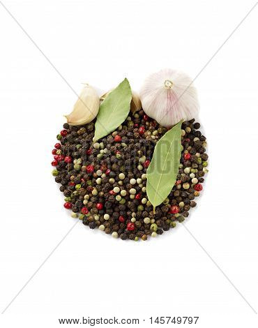 Spices: garlic, peppercorns, bay leaf isolated on a white background.