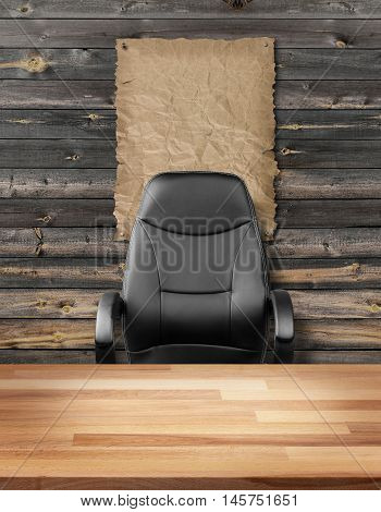 Empty executive chair in front of a rough wall with blank wanted poster