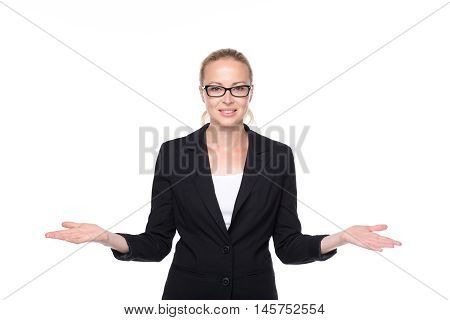 Beautiful young businesswoman smiling, holding open palms with empty copy space. Business woman showing hands sign to sides, concept of advertisement or comparing products. White background.