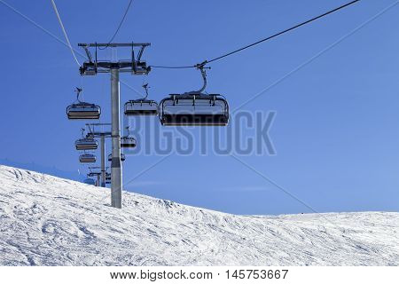 Ski-lift And Off-piste Slope In Sun Cold Day