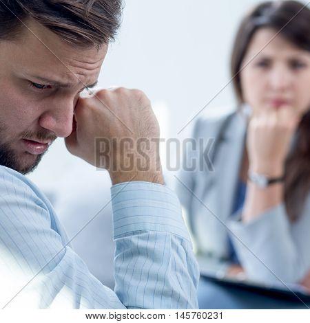 Resigned Man At Psychiatrist's Office