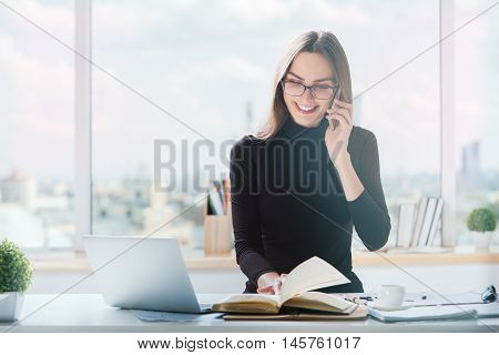 Woman On Phone Doing Paperwork