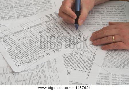 Internal Revenue Service tax forms for the filing of annual taxes. poster