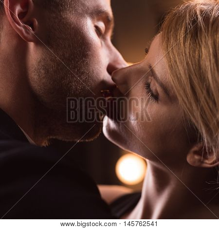 Handsome Couple Having French Kiss