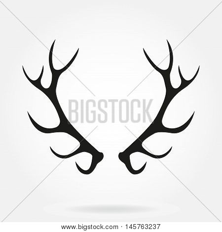 Deer antlers. Horns icon isolated on white background. Vector black silhouette.