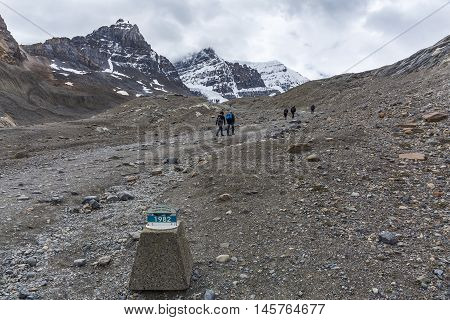 Hikers On The Columbia Ice Field And 1982 Marker