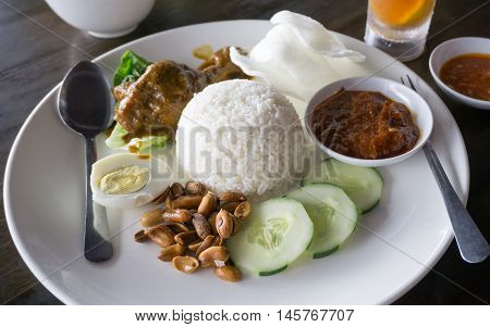 Nasi Lemak Served In The Restaurant, Famous Malaysia Dish.