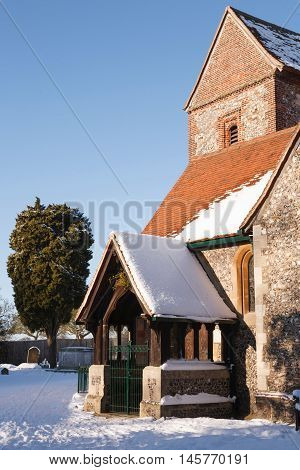 Old English church covered in snow in winter