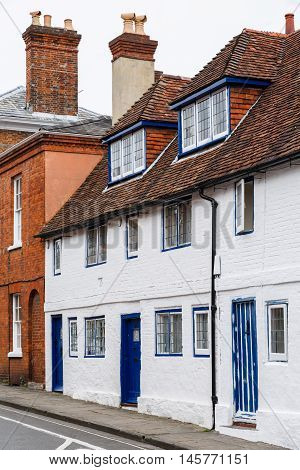 Row of old English terraced houses in Winchester Hampshire UK