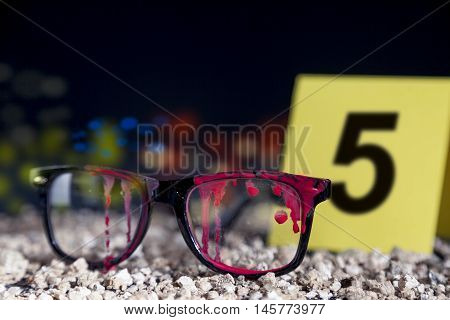 Bloody Glasses At The Crime Scene In The Night
