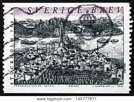 SWEDEN - CIRCA 2002: a stamp printed in the Sweden shows Town and Lake Malaren Painting of Stockholm 1535 Stockholm 750th Anniversary circa 2002