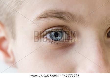 Extreme Close Up Of Blond And Blue Eyed Child