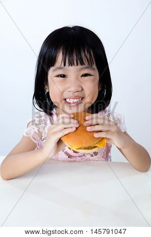 Happy Asian Chinese Little Girl Eating Burger
