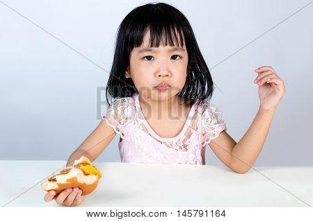 Asian Chinese Little Girl Refusing Eating Burger