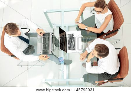 Image of business partners discussing ideas and working on lapto