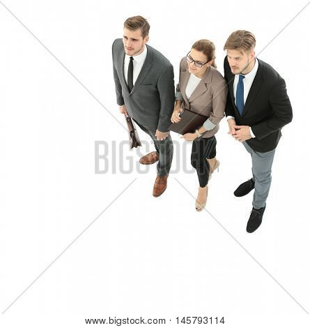 Happy business people looking at something  isolated on white