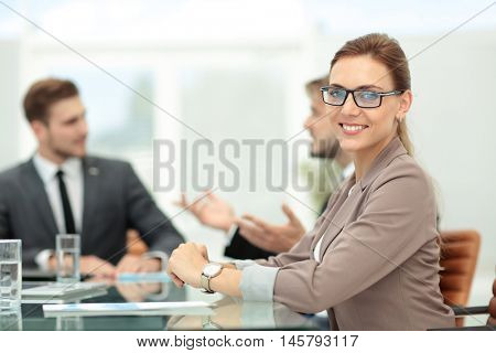 Successful beautiful business woman working with her staff