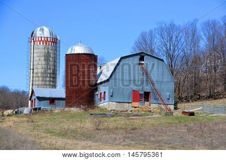 BROMONT QUEBEC CANADA APRIL 10 2016: Early spring old farm in country side of Bromont it is in the Brome-Missisquoi Regional County Municipality
