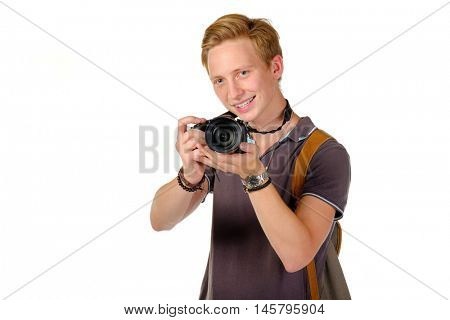 Young man traveler taking pictures by dslr camera isolated on white