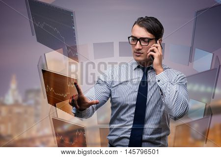 Young trader talking on the phone