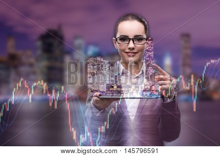 Young businesswoman in financial trading concept