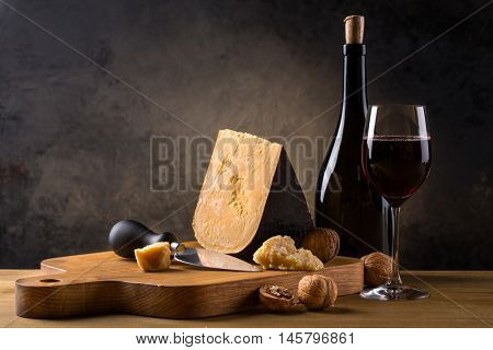 served cheese and wine on old wooden table