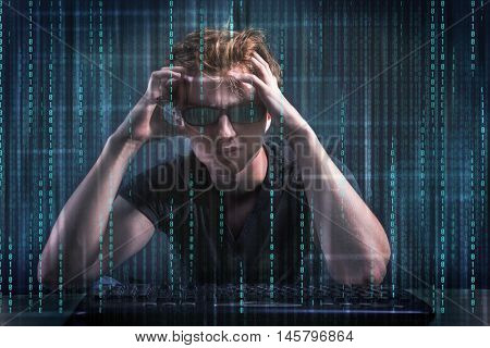 Young hacker in digital security concept