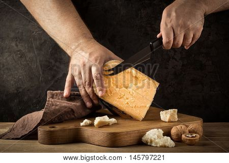 cutting cheese on wooden board