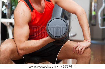 Man training hard in a gym