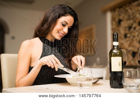 Smiling woman eating at a restaurant