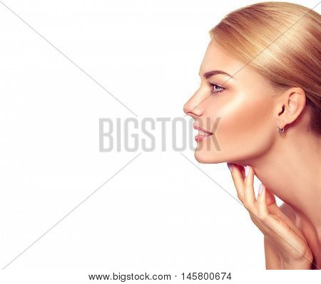 Beauty Portrait. Beautiful Spa Blonde Woman Touching her Face. Perfect Fresh Skin. Beauty Middle aged Model. Youth and Skin Care Concept. Studio shot. Isolated on white background