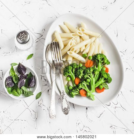 Pasta with broccoli. Delicious healthy vegetarian lunch. On a light background