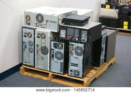stacking obsolete computers and workstations in office poster
