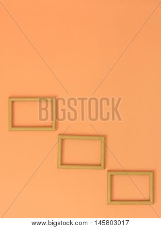 Classic Wooden Frame On Orange Cement Wall