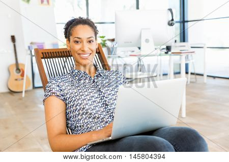 Portrait of smiling afro-american office worker in offfice