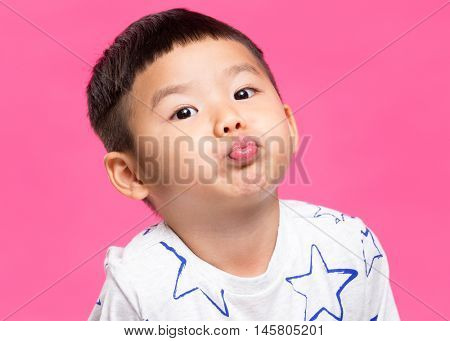 Asian little boy pout his lip