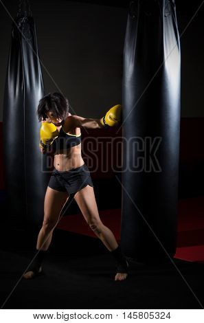 Training of kickboxer woman at gym