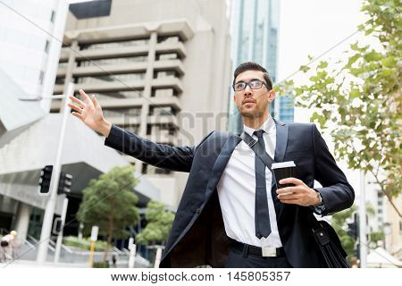 Young businessman hailing for a taxi