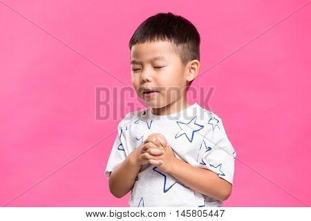 Asian little boy praying