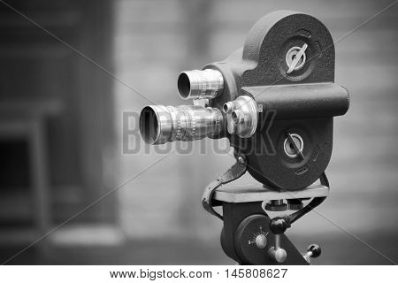 Retro movie camera on a tripod. Processed with black & white stylecan be used for background