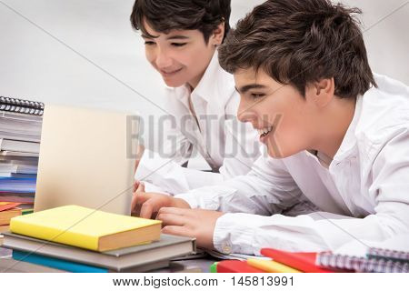 Happy schoolboys studying, two smart friends searching information on the internet for resolving difficult home task, back to school concept