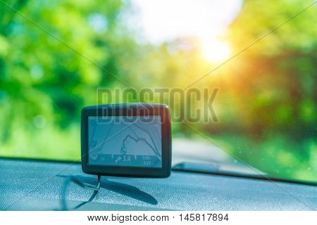 GPS navigator in the car, good help for travelers to find a necessary road, modern technology, electronic maps